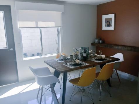 Comedor, en el modelo Yulán, casa de arquitectura minimalista, en La Rioja Residencial