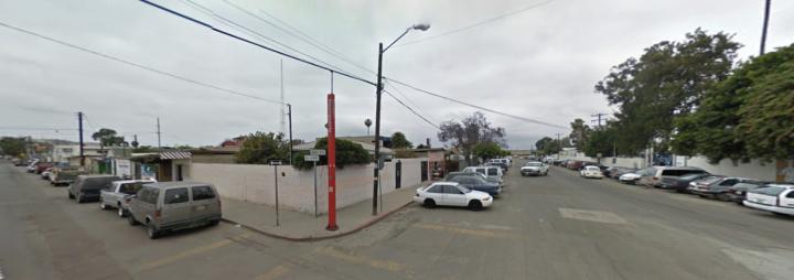 Propiedad de Material en Zona Centrica de Tijuana, con Amplio Estacionamiento, Terreno Libre Para Continuar Construcción; Vocación Comercial, Inmuebles Adjudicados Tijuana del Lic. Abel Jiménez